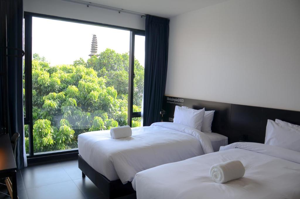 Two single beds with natural view outside
